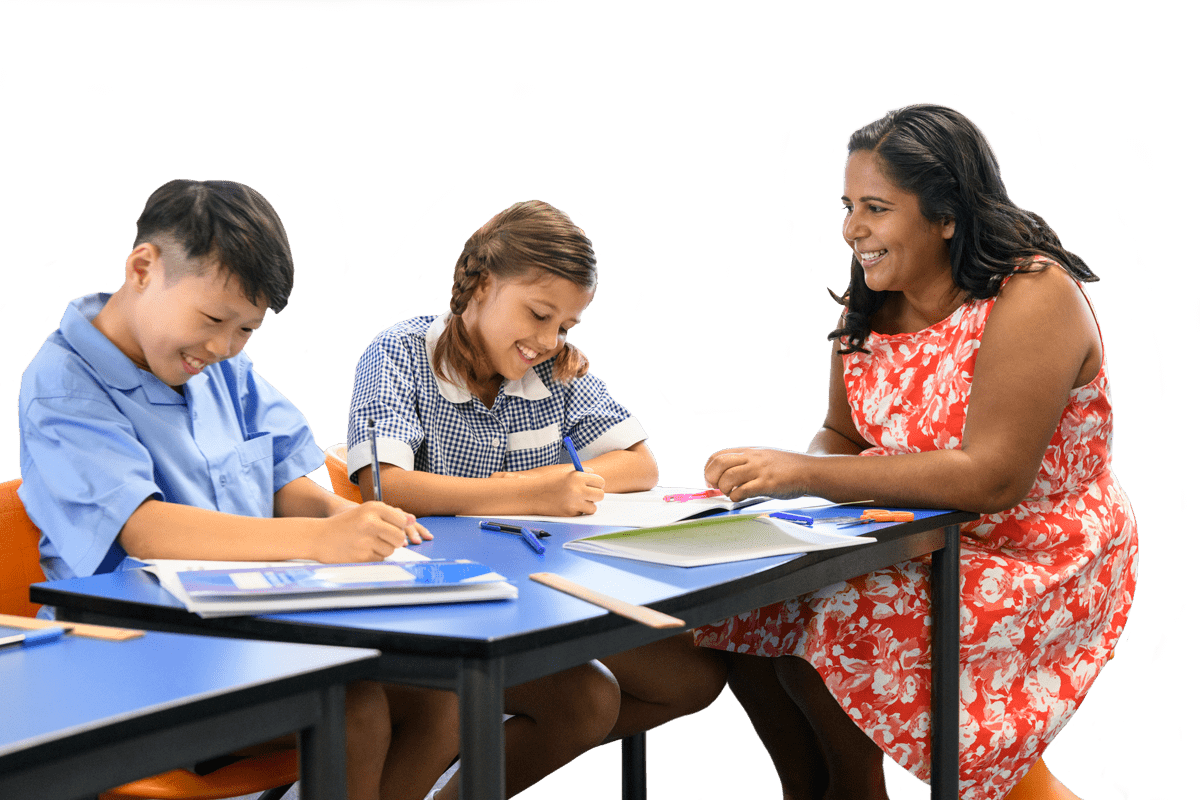Teacher helping two students with writing
